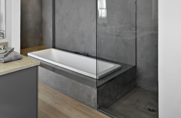Micro topped polished concrete Arcascreed beton cire applied on bathroom walls